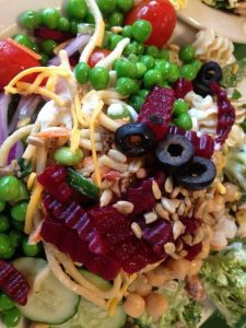 Summer salad with peas, beetroot and healthy vegetables